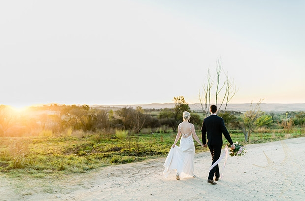 Bride and Groom walk off into the sunset