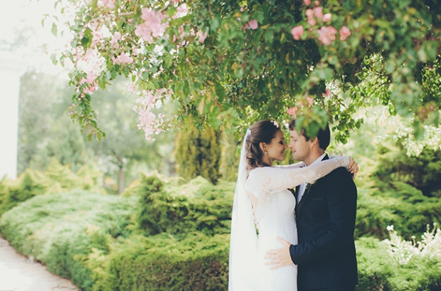wedding couple embracing each other under a tree