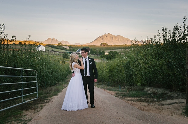 Wedding Couple on Gravel Road at Brenaissance Wine Estate Stellenbosch